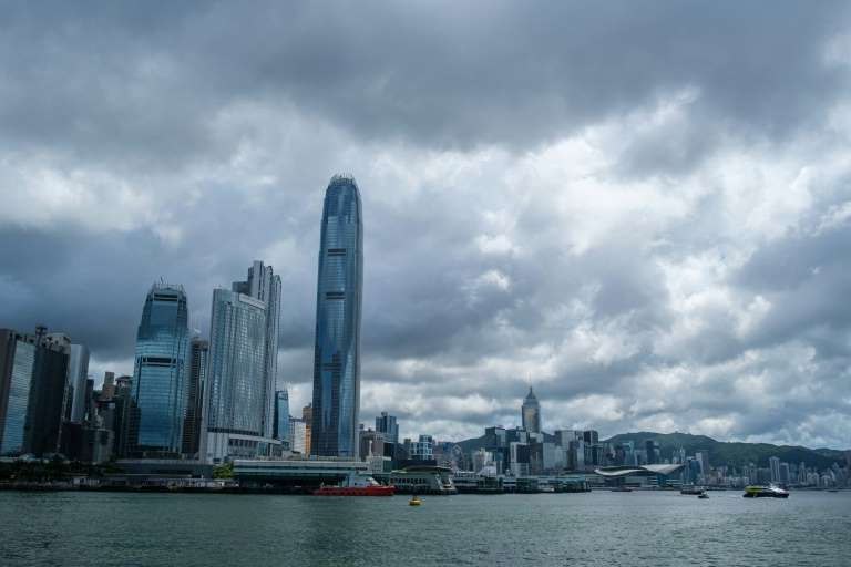 a large body of water with a city in the background: The United States no longer deems Hong Kong sufficiently autonomous from China to grant it special trading status