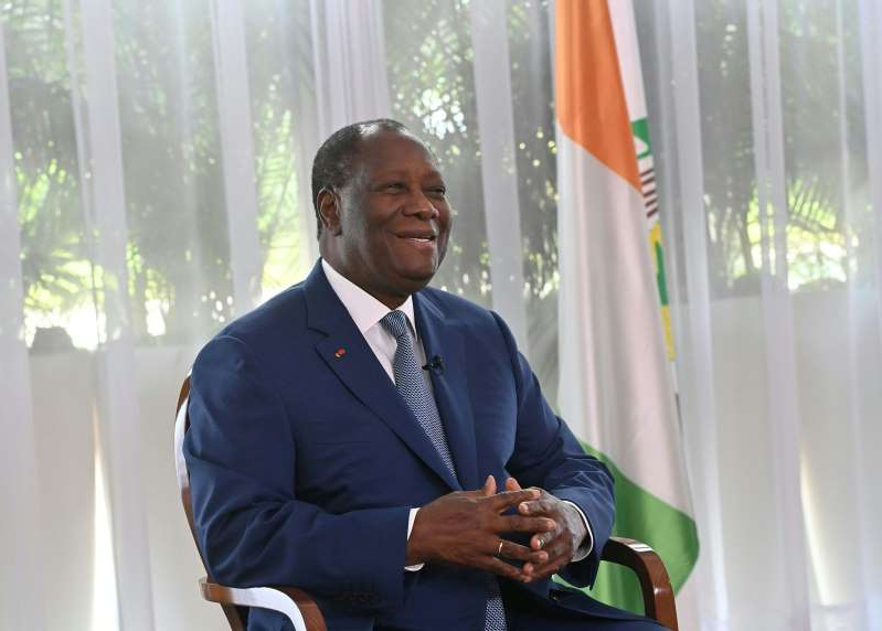 Alassane Ouattara wearing a suit and tie talking on a cell phone: Alassane Ouattara at the presidential palace in Abidjan on Oct. 28.