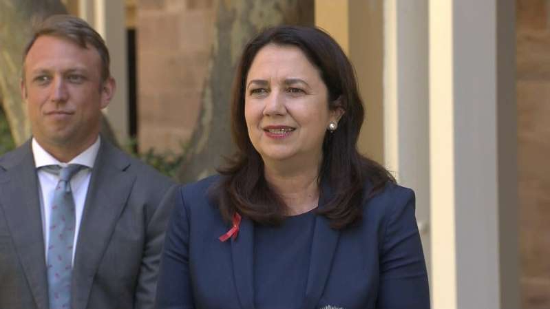 Annastacia Palaszczuk wearing a suit and tie: Annastacia Palaszczuk makes an announcement on Queensland's border restrictions.