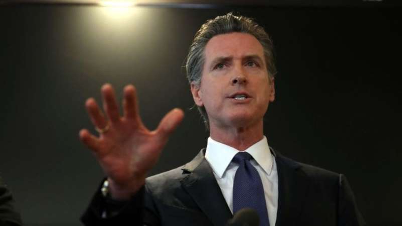 Gavin Newsom wearing a suit and tie: California governor preparing state for civil unrest following election