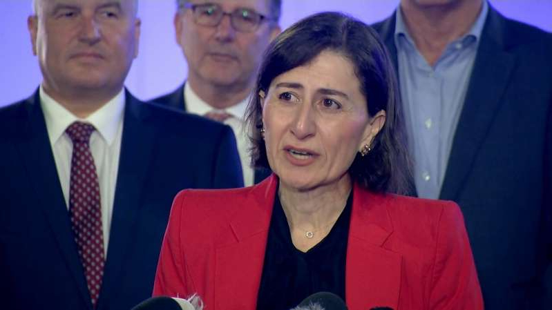 Gladys Berejiklian et al. posing for the camera: NSW Premier Gladys Berejiklian has claimed Queensland won't be announcing the re-opening of its border with NSW today.
