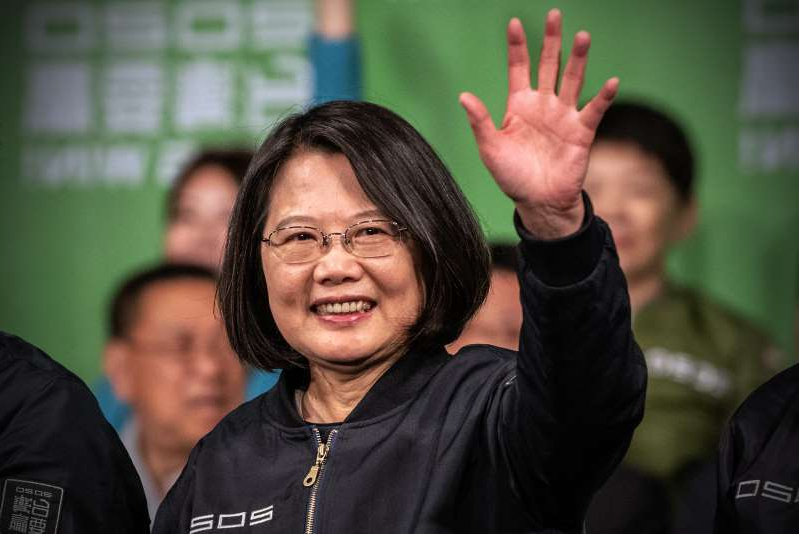 Tsai Ing-wen et al. taking a selfie: President Tsai Ing-wen waves after addressing supporters following her reelection on Jan. 11, 2020 in Taipei, Taiwan.