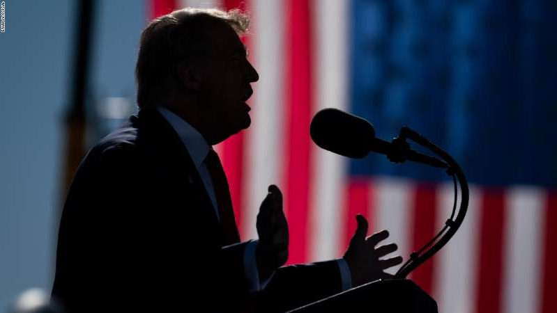 a man standing in front of a mirror posing for the camera: President Donald Trump speaks during a campaign rally at Phoenix Goodyear Airport, Wednesday, Oct. 28, 2020, in Goodyear, Ariz. (AP Photo/Evan Vucci)