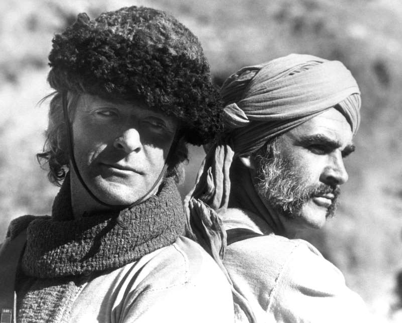a man wearing a hat: Sean Connery and Michael Caine in Rudyard Kipling's The Man Who Would Be King (PA)