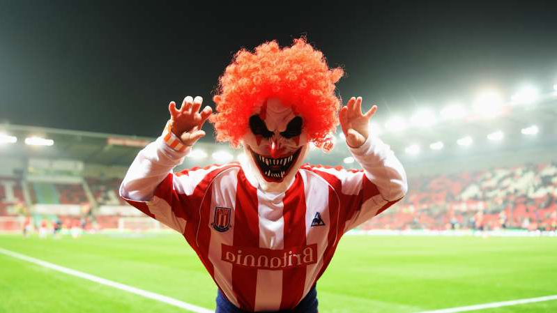 a person wearing a costume: A Stoke City fan parades in a Halloween fancy dress costume