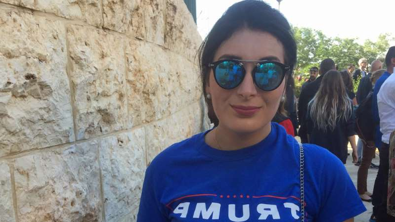 a woman in sunglasses standing in front of a building: Loomer is attempting to become the youngest member of Congress [File: Linah Alsaafin/Al Jazeera]