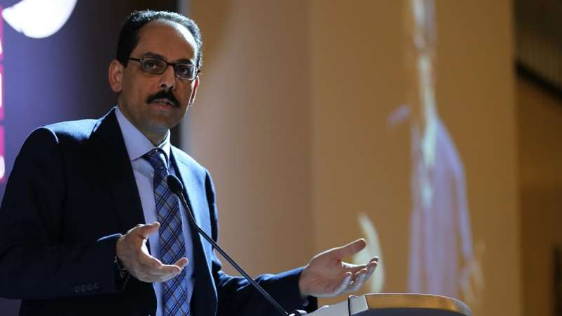İbrahim Kalın wearing a suit and tie: Ibrahim Kalin, Erdogan's spokesman, said he had light COVID-19 symptoms and was nearing the end of treatment [File: Guray Ervin/Al Jazeera]