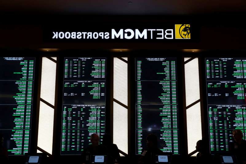a lit up city at night: BetMGM is a renowned sportsbook casino in the U.S. (AP Photo/Paul Sancya)