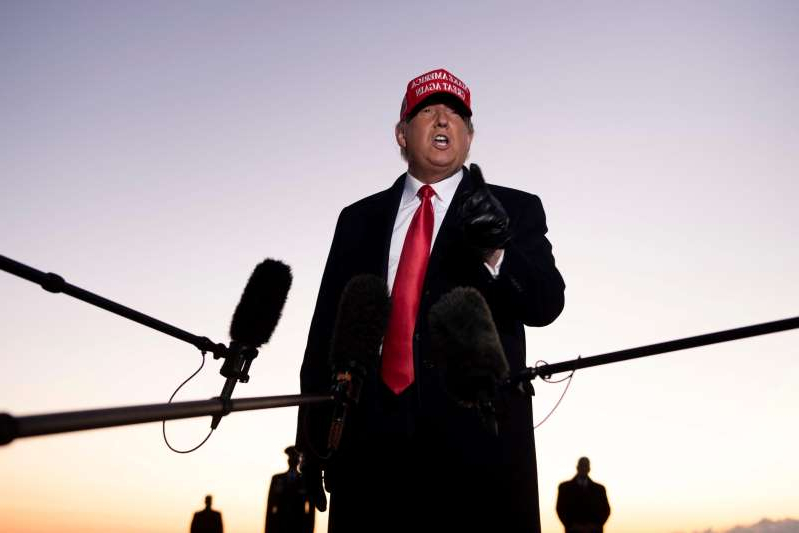 Donald Trump standing on top of a pole: President Donald Trump speaks to the press at Charlotte Douglas International Airport on Nov. 1. Trump vowed to again defy the polls as he sprinted through five swing states in a blitz of campaigning against Joe Biden with just two days left before the US presidential election.