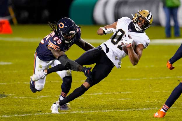 Slide 1 of 48: New Orleans Saints wide receiver Tre'Quan Smith (10) is tackled by Chicago Bears inside linebacker Danny Trevathan (59) after picking up a first down during overtime of an NFL football game in Chicago, Sunday, Nov. 1, 2020.