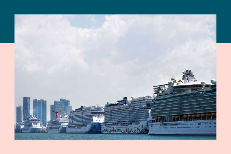 a large ship in a body of water: Cruise ships are seen docked at Miami port.