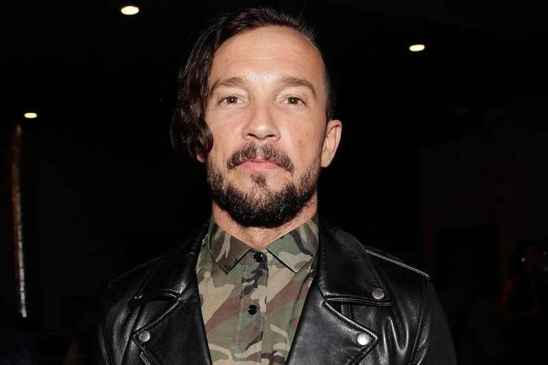 a man wearing a suit and tie: Shareif Ziyadat/WireImage Carl Lentz