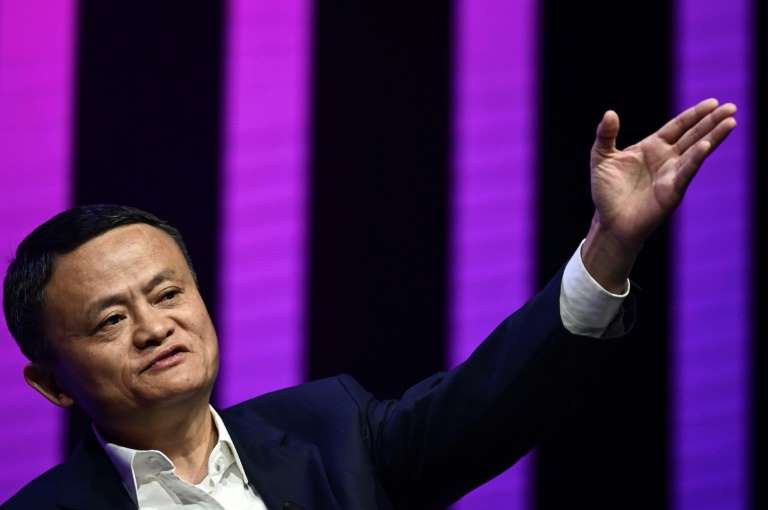 Jack Ma standing on a stage: Jack Ma, co-founder of ecommerce titan Alibaba, had stood to become Asia's richest man via Ant Group's IPO
