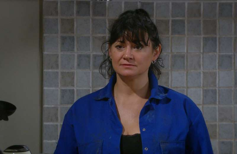 a person in a blue shirt: Moira Dingle in Emmerdale