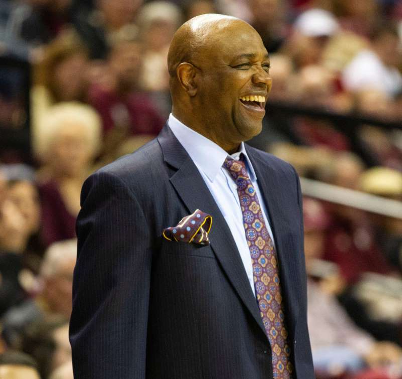 Leonard Hamilton wearing a suit and tie: Florida State Seminoles head coach Leonard Hamilton laughs as his players finish out the game and claim their victory. The Florida State Seminoles beat the Boston College Eagles 80-62, Saturday, March 7, 2020. The Seminoles clinched the ACC regular season title.