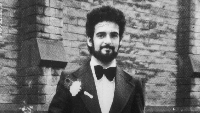 Peter Sutcliffe standing in front of a mirror posing for the camera: A portrait of British serial killer Peter Sutcliffe, known as