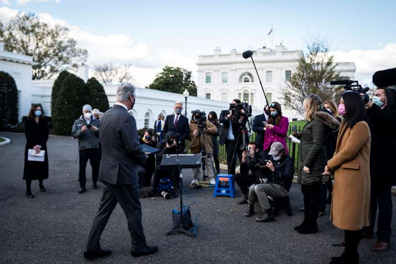 a group of people standing in front of a crowd posing for the camera: White House reporters await a press conference with national security adviser Robert C. O'Brien outside the West Wing on Tuesday.