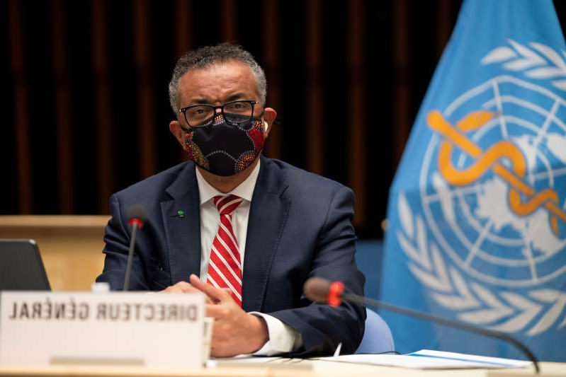 a man wearing a suit and tie: Tedros Adhanom Ghebreyesus, director general of the World Health Organization, attends a session on the coronavirus disease outbreak response of the WHO Executive Board in Geneva, Oct. 5, 2020.