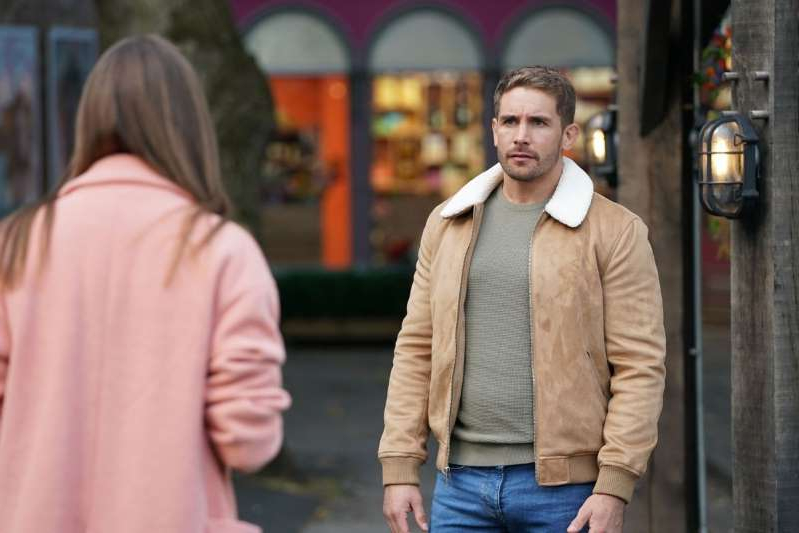 Adam Woodward et al. walking down a street: Sienna Blake and Brody Hudson in Hollyoaks