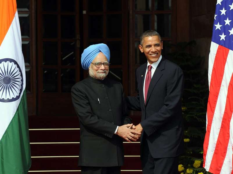 Barack Obama, Mohan Singh are posing for a picture: Barack Obama and former Indian Prime Minister Manmohan Singh Prakash Singh/AFP via Getty Images