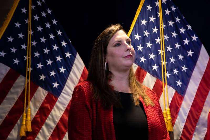 Ronna Romney wearing a colorful umbrella: Ronna McDaniel, chairwoman of the Republican National Committee, listens during a news conference in Washington Nov. 9.
