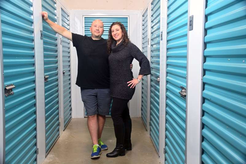 a person standing in front of a window posing for the camera: Lindsay and Mike Steiner founded Bradyl Storage Solutions to fill demand for secure and portable storage units in apartment buildings. (Photo by Marvin Joseph/The Washington Post)