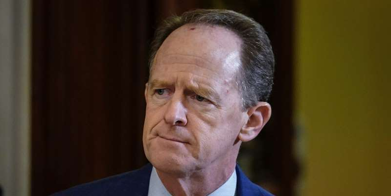 Pat Toomey wearing a suit and tie looking at the camera: Sen. Pat Toomey (R-PA) leaves the Senate chamber during a recess in the Senate impeachment trial of U.S. President Donald Trump continues at the U.S. Capitol on January 30, 2020 in Washington, DC. Getty Images/Drew Angerer