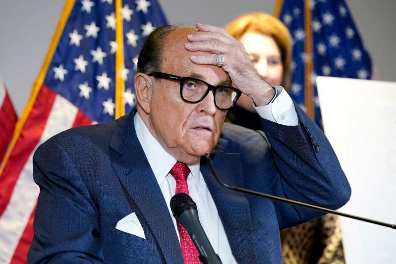Rudy Giuliani wearing a hat and glasses: A federal judge Saturday emphatically rejected President Trump's lawsuit seeking to overturn the Pennsylvania election results — and trashed Rudy Giuliani's much-mocked performance in his courtroom.
