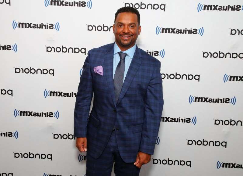 Alfonso Ribeiro wearing a suit and tie