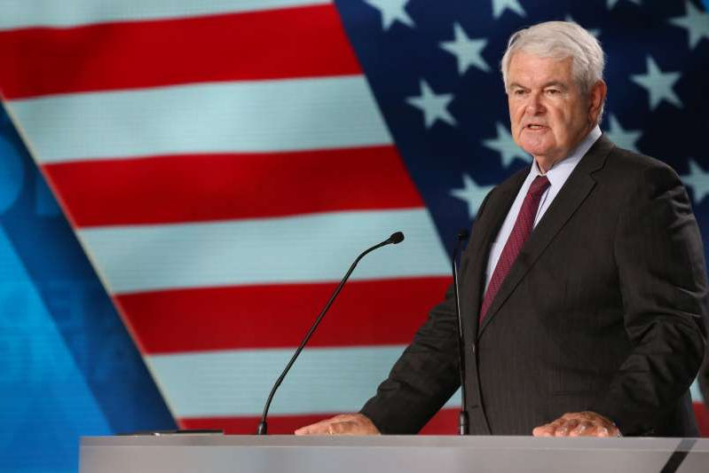 Newt Gingrich wearing a suit and tie: Newt Gingrich, former US Speaker of the House attends