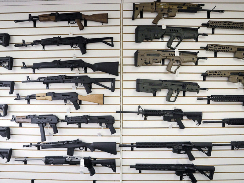 "a close up of a gun: Gun retailers and owners were deeply critical of Prime Minister Justin Trudeau's sweeping ban, saying it arbitrarily outlawed ""military-style"" firearms based solely on how they look."