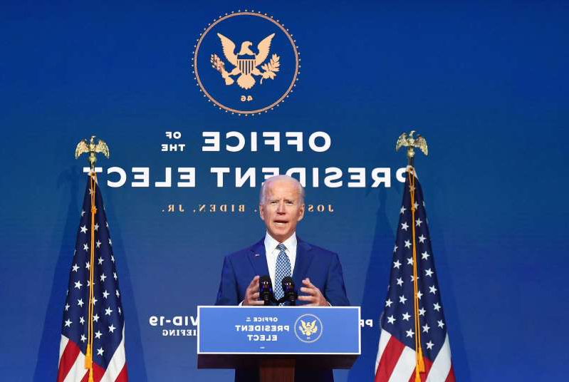 a close up of a sign: President-elect Joe Biden delivers remarks at The Queen in Wilmington, Delaware, on November 9, 2020. President Donald Trump was still refusing to concede his election loss November 9, 2020, but Democrat Joe Biden plowed ahead anyway with the first meeting of a parallel coronavirus task force, initiating an awkward and potentially volatile transition period.