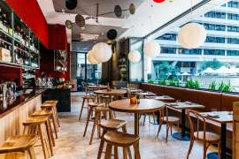 a dining room table: Sydney restaurant-wine-bar Monopole has relocated to the CBD.
