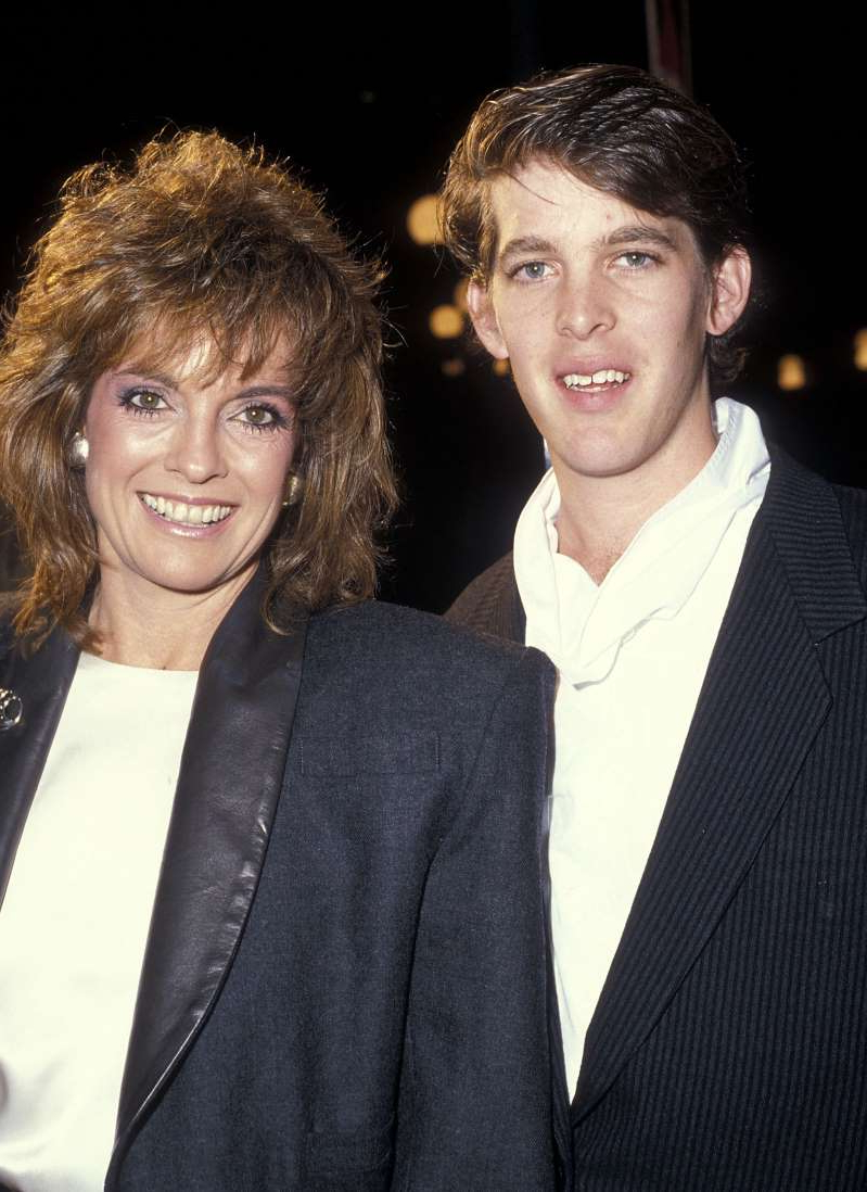 Linda Gray et al. posing for the camera: Linda Gray and son Jeff Thrasher in 1985.