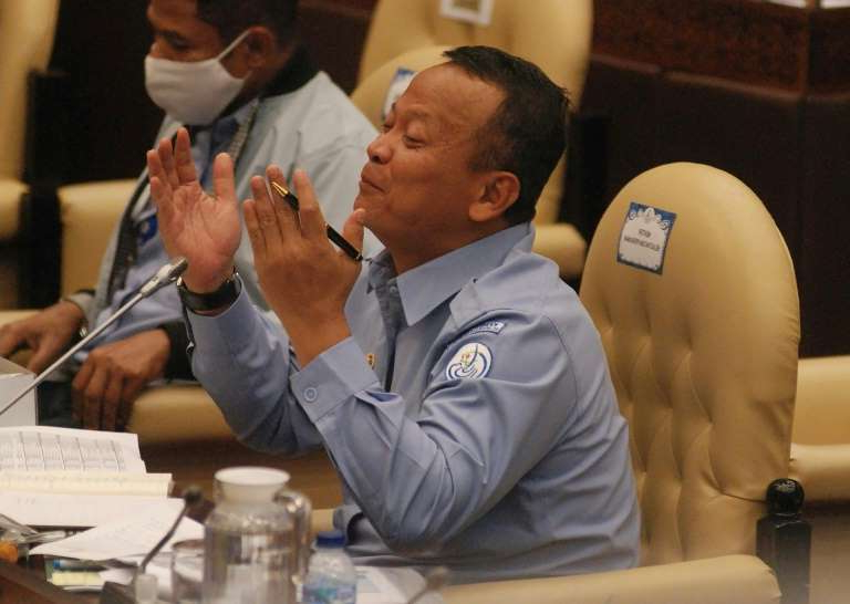 a group of people sitting at a table: Indonesian Maritime Affairs and Fisheries Minister Edhy Prabowo has been arrested over allegations of graft linked to exporting baby lobsters