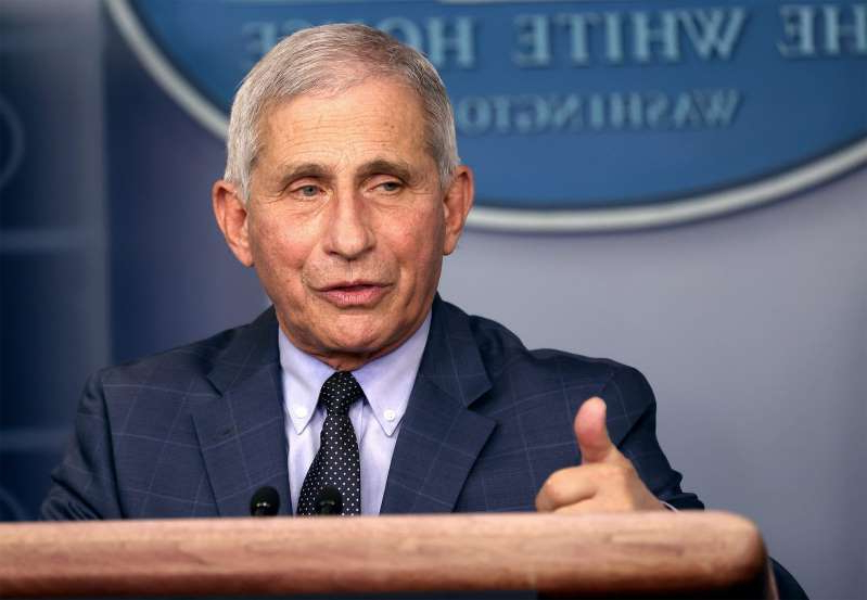 Anthony S. Fauci wearing a suit and tie: WASHINGTON, DC - NOVEMBER 19: Dr. Anthony Fauci, Director of the National Institute of Allergy and Infectious Diseases, speaks during a White House Coronavirus Task Force press briefing in the James Brady Press Briefing Room at the White House on November 19, 2020 in Washington, DC. The White House held its first Coronavirus Task Force briefing in months as cases of COVID-19 are surging across the country ahead of the Thanksgiving holiday. (Photo by Tasos Katopodis/Getty Images)
