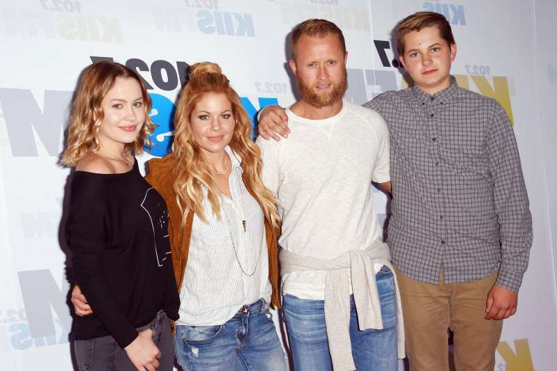 Candace Cameron Bure et al. posing for a photo: Jeffrey Mayer/WireImage Candace Cameron Bure and family