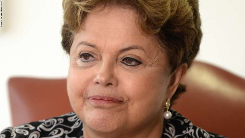 Dilma Rousseff wearing glasses and smiling at the camera: Brazilian President Dilma Rousseff attends a meeting with Rupert Stadler, World President of Audi AG, at Planalto Palace in Brasilia on September 17, 2013.