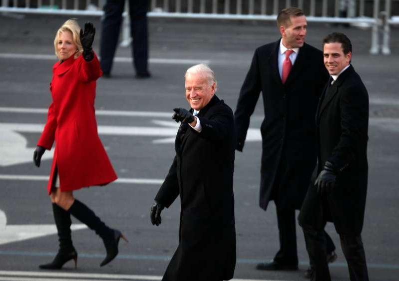 Hunter Biden, Beau Biden, Joe Biden, Jill Biden are posing for a picture: Vice President Joe Biden, with sons Hunter Biden and Beau Biden, and second lady Jill Biden, walk down Pennsylvania Avenue during the inaugural parade for President Barack Obama, Jan. 20, 2009, in Washington.