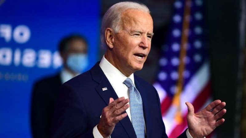 Joe Biden wearing a suit and tie: Biden says transition outreach from Trump administration has been 'sincere'
