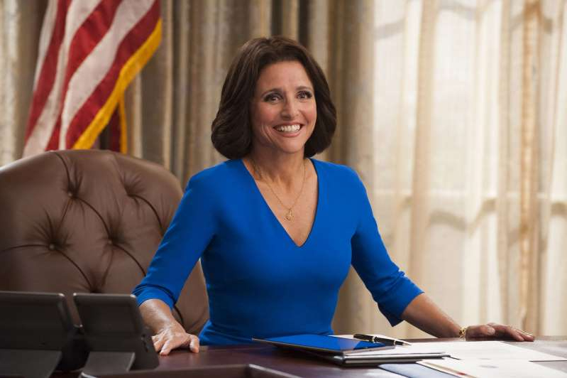 Julia Louis-Dreyfus standing in front of a blue table: Julia Louis-Dreyfus in Veep