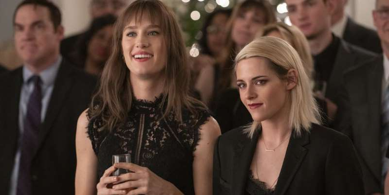 Kristen Stewart, Mackenzie Davis posing for the camera: Happiest Season, starring Kristen Stewart and Mackenzie Davis, is being released digitally in the US and UK. Here's how to watch Happiest Season online.
