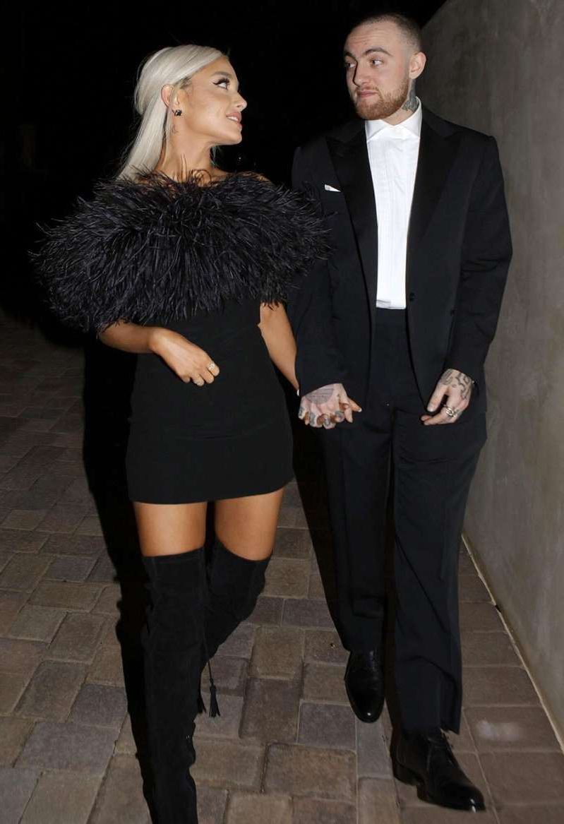 Mac Miller wearing a suit and tie standing next to a woman: GC Images Mac Miller and Ariana Grande