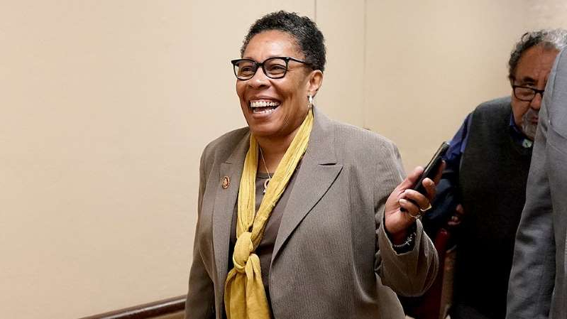 Marcia Fudge wearing a suit and tie holding a cell phone: Major unions back Fudge for Agriculture secretary