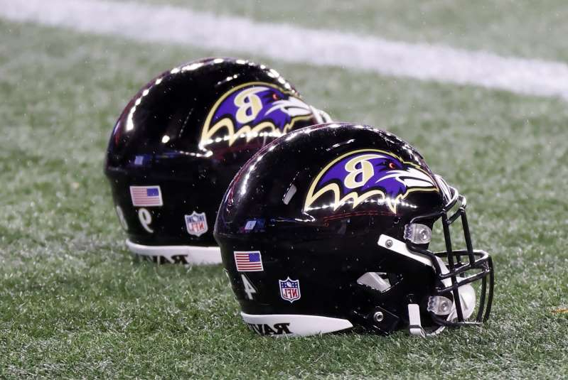 a person with a helmet on top of a grass covered field: The Ravens continue to have COVID-19 issues. (Photo by Fred Kfoury III/Icon Sportswire via Getty Images)