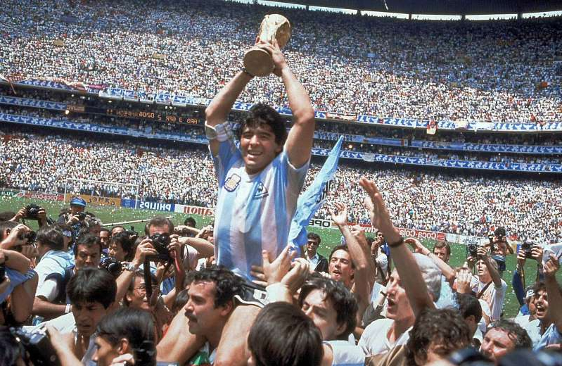 Diego Maradona et al. jumping in front of a crowd: Diego Maradona led Argentina to the 1986 World Cup title.