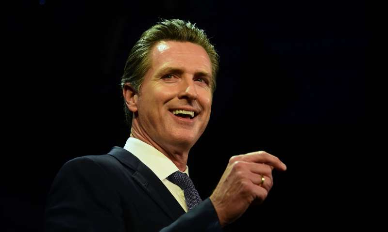 Gavin Newsom wearing a suit and tie: After exposed to the coronavirus by his children, California Governor Gavin Newsom and his family began self-quarantining on Monday. All members of Newsom's immediate family have tested negative for COVID-19.