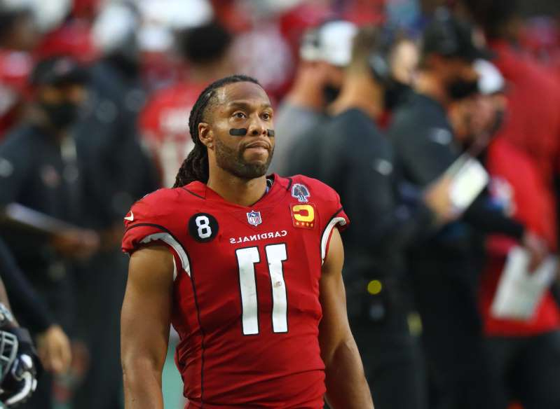 Larry Fitzgerald standing in front of a crowd