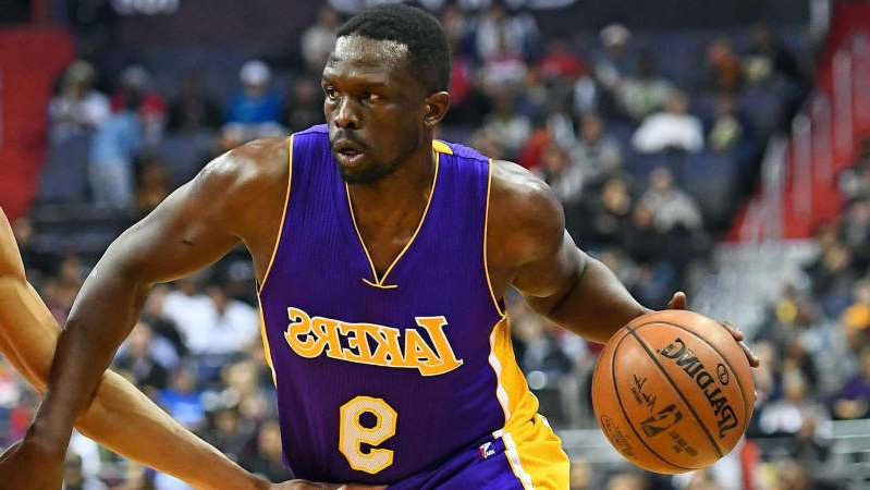 Luol Deng holding a basketball