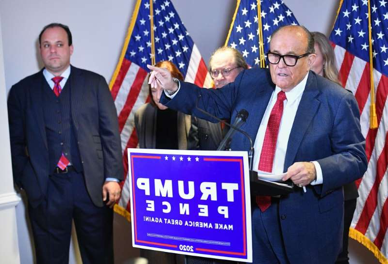 Rudy Giuliani, Boris Epshteyn are posing for a picture: This November 19 photo shows the personal lawyer of President Donald Trump, Rudy Giuliani, speaking at a press conference at the Republican National Committee headquarters in Washington, D.C.